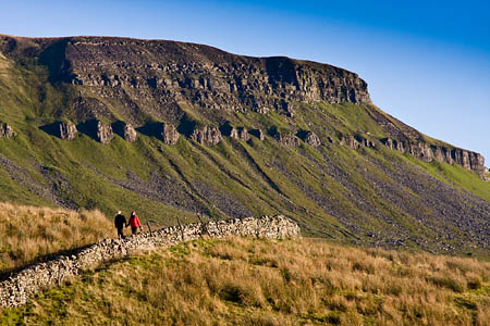 Walkers descend on the Pennine Way near Tarn Bar, with Pen-y-ghent in the background