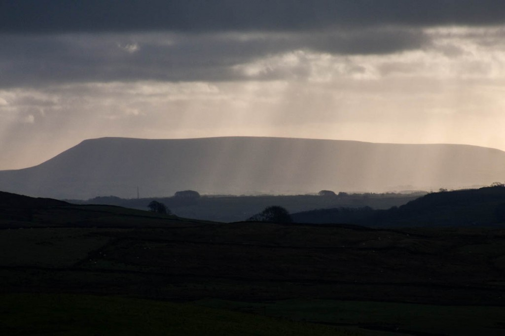 Pendle Hill's bulky profile dominates the Ribble Valley