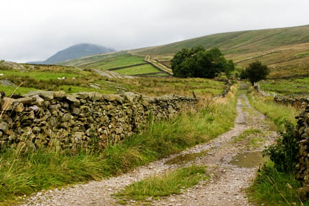 Long Lane, Helwith Bridge, with Pen-y-ghent in the distance, on the route of A Pennine Journey