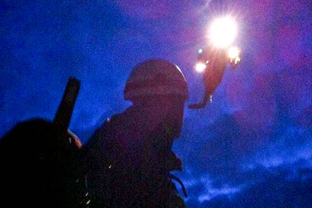 A Penrith MRT member with a helicopter as night draws in