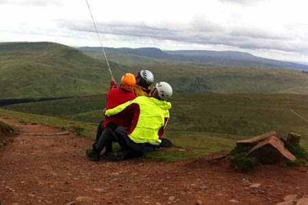 Rescuers prepare for the helicopter winching. Photo: Brecon MRT