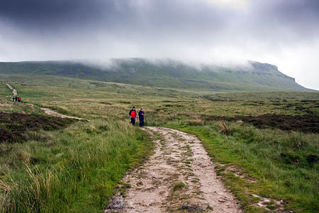 Walkers descend Pen-y-ghent, one of Yorkshire's Three Peaks