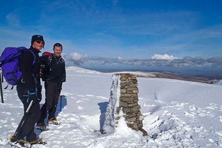 Lake District fell top assessor Jon Bennett on Helvellyn's summit with last year's eBay winner Peter Sharratt