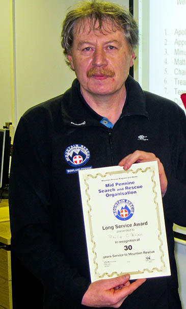 Phil O'Brien with his 30-year-service certificate with the Bowland Pennine team