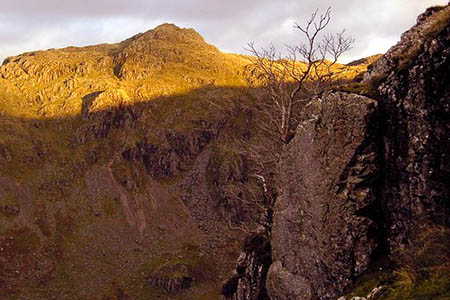 The climber died after a fall on Raven Crag, right, and Rosthwaite Fell. Photo: Colin Kinnear CC-BY-SA-2.0