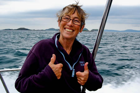 Ms Betys celebrates after her swim. Photo: Rory Syme/John Muir Trust
