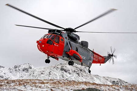 A Royal Navy Sea King helicopter winched the injured climber from the mountain. Photo: Stuart Hill/MoD/Crown Copyright