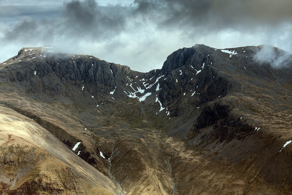 The shortest route up Scafell Pike, left, is used by Three Peaks Challengers