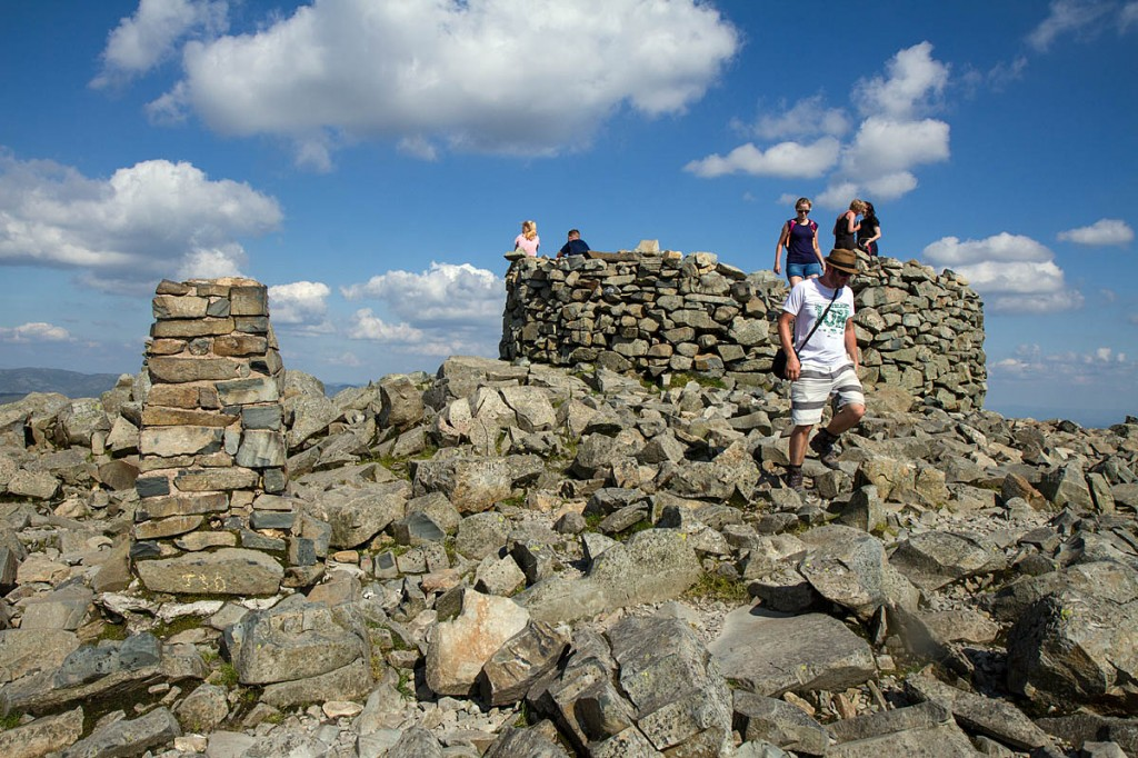 The summit of Scafell Pike, seldom a place for solitude in the summer months