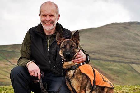 Handler Ian Higginbotham with trainee search dog Keppi