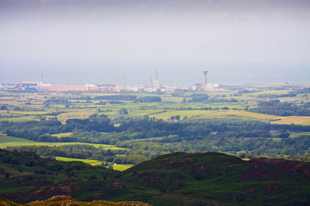 The coalition still plans to build extra nuclear capacity at Sellafield, visible from much of the Lake District