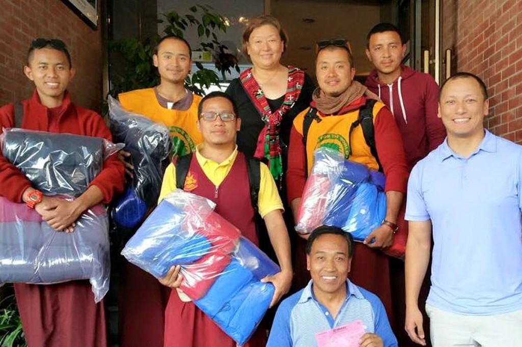 Some of the Sherpa Adventure Gear blankets are handed over