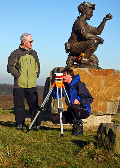 The surveyors on Silverhill, Nottinghamshire, which the county council claims is the highest point in the county. Photo: Myrddyn Phillips