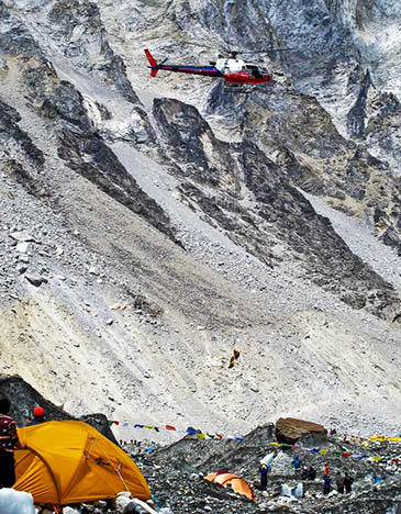 Simone Moro pilots his helicopter during the rescue high on Everest. Photo: David Hamilton/Jagged Globe