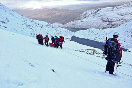 The walker is stretchered down the mountain by rescuers. Photo: Aberglaslyn MRT