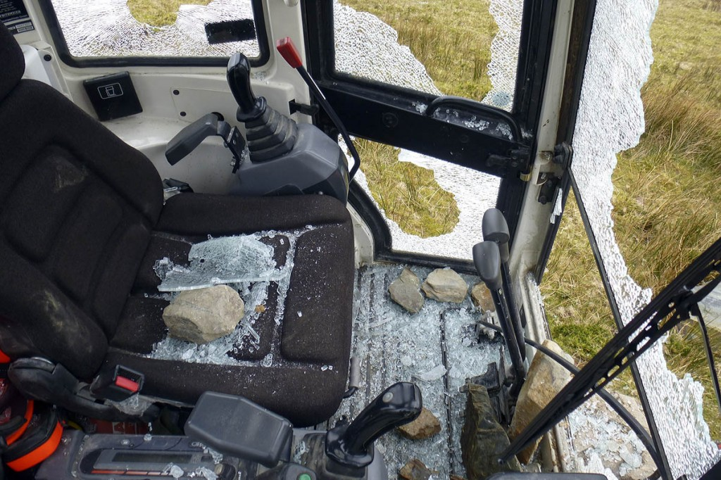 Stones were used to smash the digger's windows