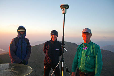 From left: Graham Jackson, Mark Greaves of OS and John Barnard beside the Leica GS15 at the top of Snowdon. Photo: Myrddyn Phillips