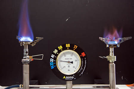A demonstration of the Soto Micro Regulator (left) at a simulated 0C, compared to a conventional gas camping stove