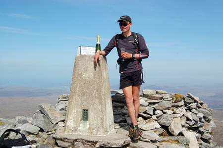 Spyke celebrates on the summit of Ben Hope in Sutherland