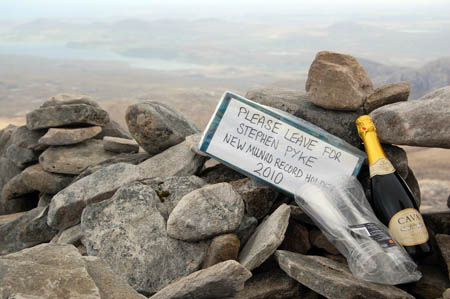 Charlie Campbell's congratulatory message and bottle were waiting for Spyke on his arrival at the summit cairn