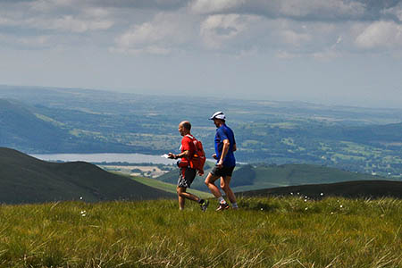 Steve Birkinshaw, right, and a support runner head from Brae Fell to Longlands Fell