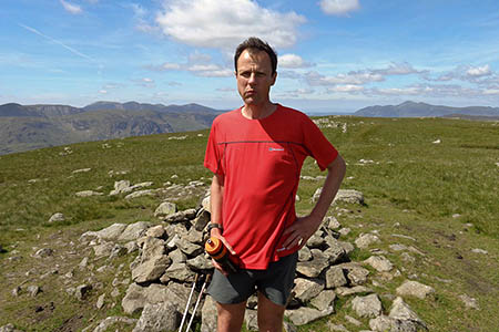 Steve Birkinshaw pauses briefly on a felltop during his Wainwright's attempt