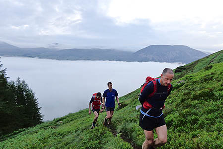 Steve Birkinshaw, centre, rises above a temperature inversion with two support runners