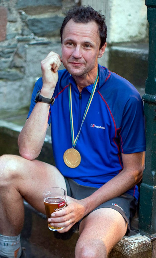 Steve Birkinshaw enjoys a drink at the end of his record-breaking Wainwrights round