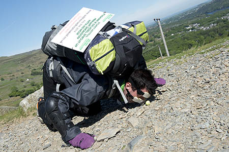 Stuart Kettell is wearing a protective noseguard to push the sprout up the mountain