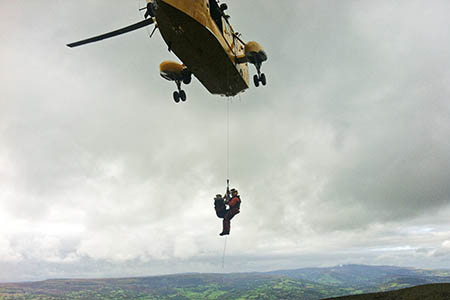 The RAF crew airlifts the walker from Sugar Loaf. Photo: Longtown MRT