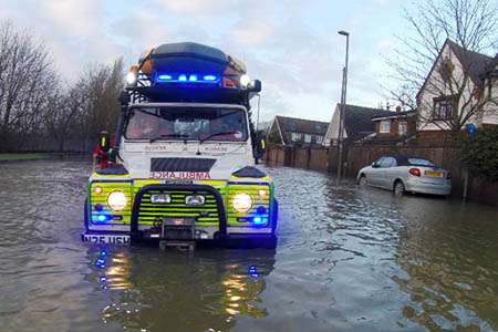 Lowland rescuers in action during the floods. Photo: Surrey SAR