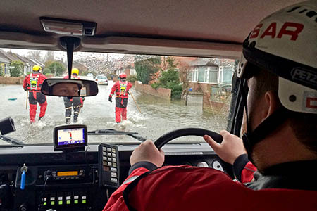 Lowland search team members in the Surrey floods. Photo: Surrey SAR