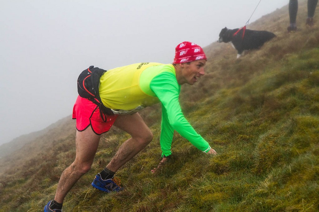 Second-placed runner Andrew Davies approaches Whernside summit
