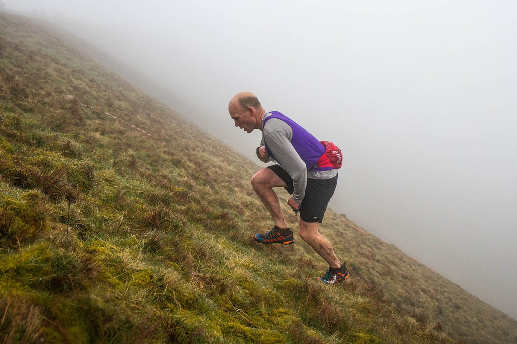 Last year's joint Fellsman winner Kim Collison makes the ascent to Whernside's summit, this time in the Three Peaks Race