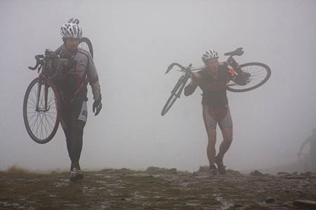 Riders approach the summit of Pen-y-ghent in the mist and gloom