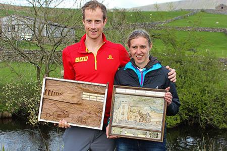 Three Peaks Race winner Ricky Lightfoot with women's winner Victoria Wilkinson. Photo: Brian Dooks