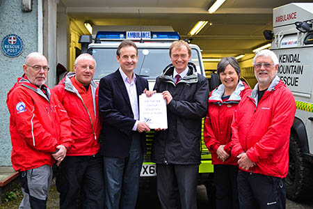 MP Tim Farron, centre right, and MEP Chris Davies show the petition, with members of the Kendal MRT