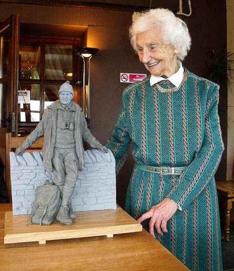 Tom Weir's widow Rhona looks at model of the statue