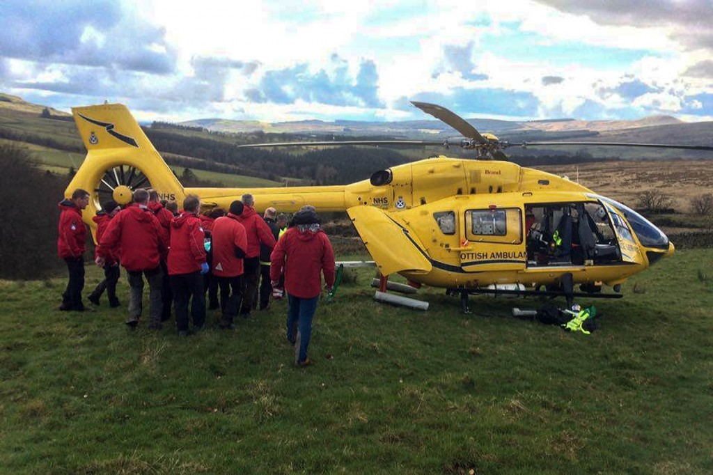 Tweed Valley team members stetcher the injured rider to the air ambulance. Photo: Tweed Valley MRT