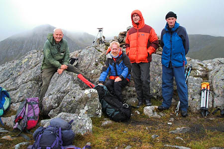 Charles Everett, Andy Nisbet, Dave McGimpsey and Graham Jackson beside the summit of Sgùrr a' Bhac Chaolais