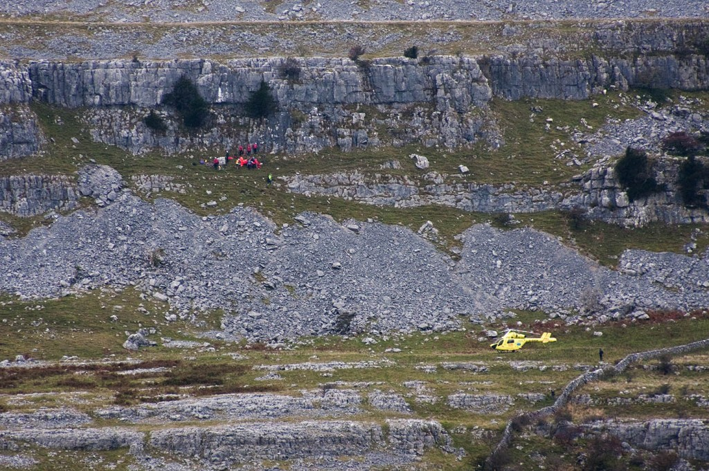 Cave Rescue Organisation members at work at the scene of the fall, as the Yorkshire Air Ambulance waits close by
