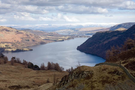 The view up Ullswater, with the snow-capped Pennines in the distance