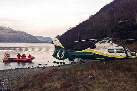 Patterdale MRT's boat brings the walker to the Great North Air Ambulance on the lake shore. Photo: GNAA