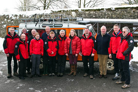 The High Sheriff, centre, joins team members at their base