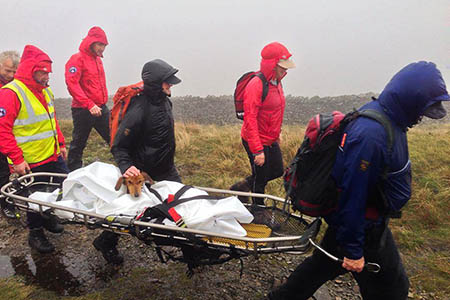 Upper Wharfedale Fell Rescue Association members stretcher 'Wufra' from Buckden Pike last year. Photo: UWFRA