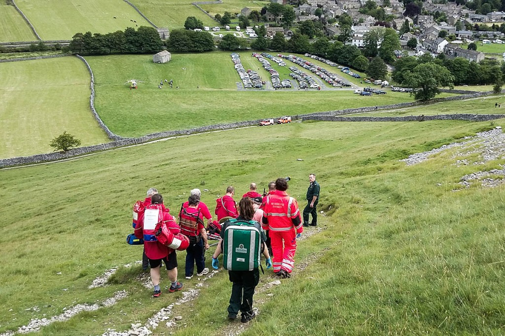 The walker is stretchered to the valley and the waiting air ambulance. Photo: UWFRA