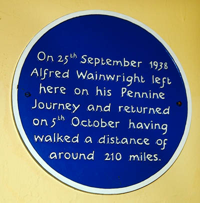 The plaque's inscription is in the style of Wainwright's handwritten guides. Photo: Derek Cockell