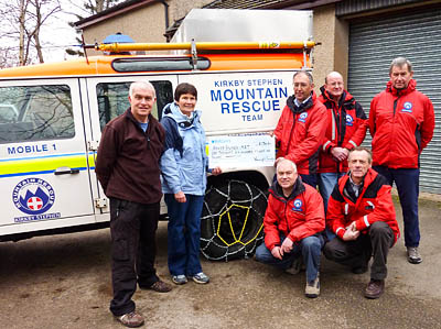 Martin Roberts and Jenny Whalley of the Wainwright Society with Kirkby Stephen MRT members, from left, David Stewart, Arthur Littlefair, Michael Saint, David Peebles-Brown and Richard Tolley. Photo: Kevin Whalley