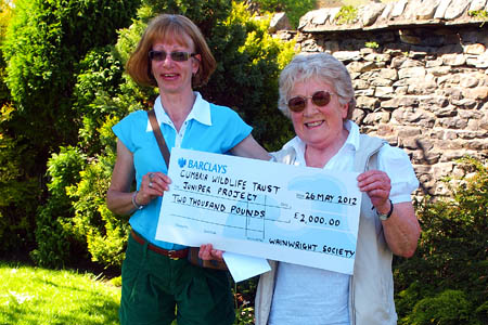 Events organiser Caroline Nichol, left, presents the cheque to Susan Garnett. Photo: Derek Cockell