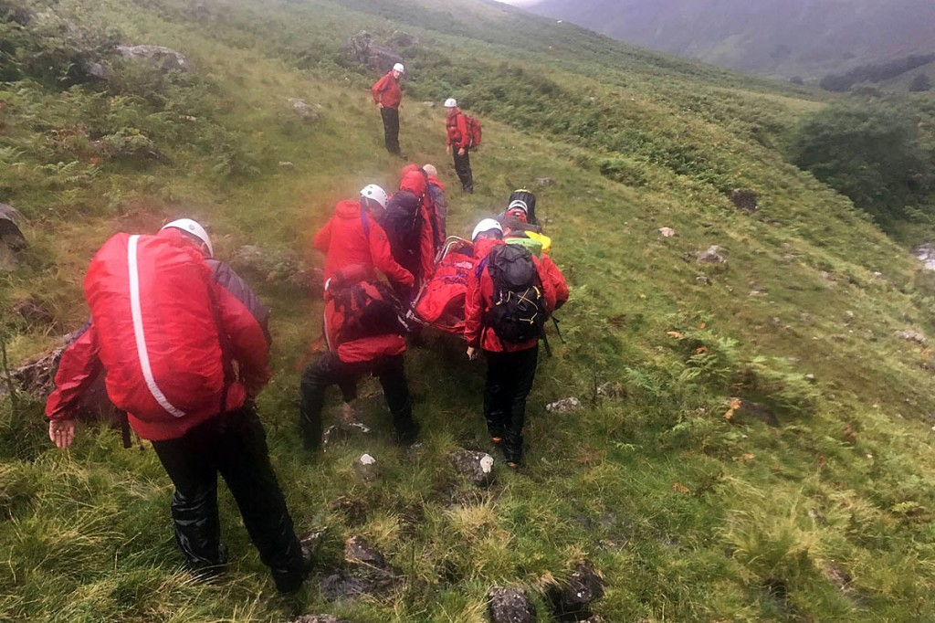 Rescuers stretcher one of the family members from the hillside. Photo: Wasdale MRT